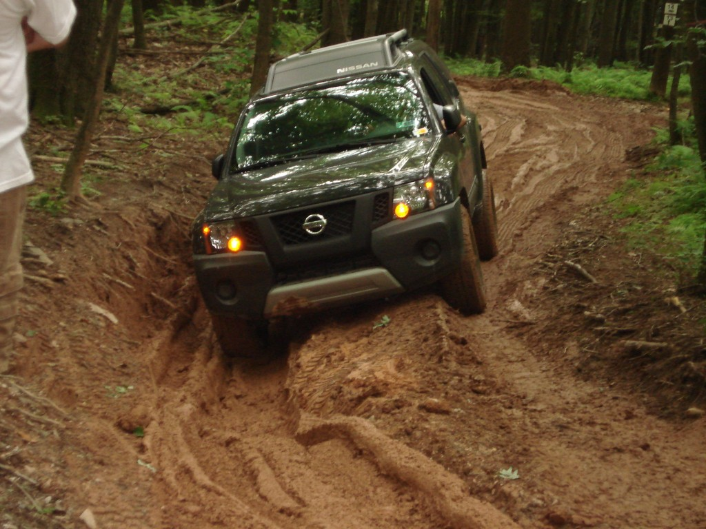 Adam wheels his new Xterra on some slick trails.